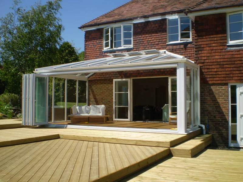 6 meter bifold doors with a glass roof above fitted near Hastings