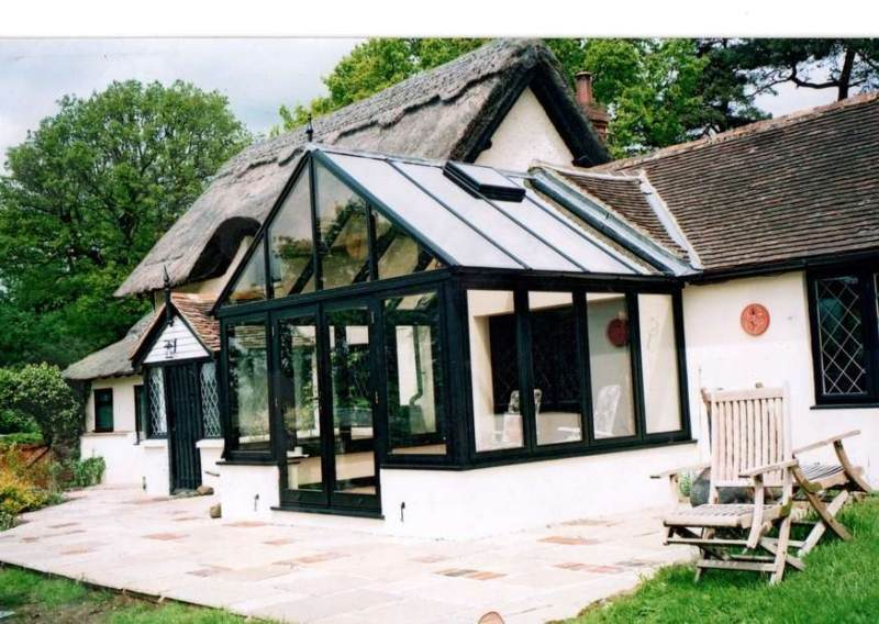 Black Hardwood conservatory with a false dormer to the house.