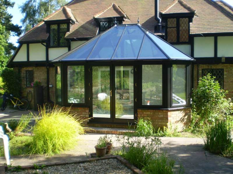 Black hardwood conservatory with full glass roof in Hythe Kent