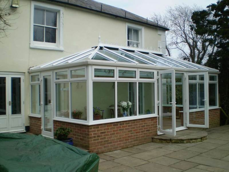 Conservatory in Hastings with a single door on the side also french doors to the front