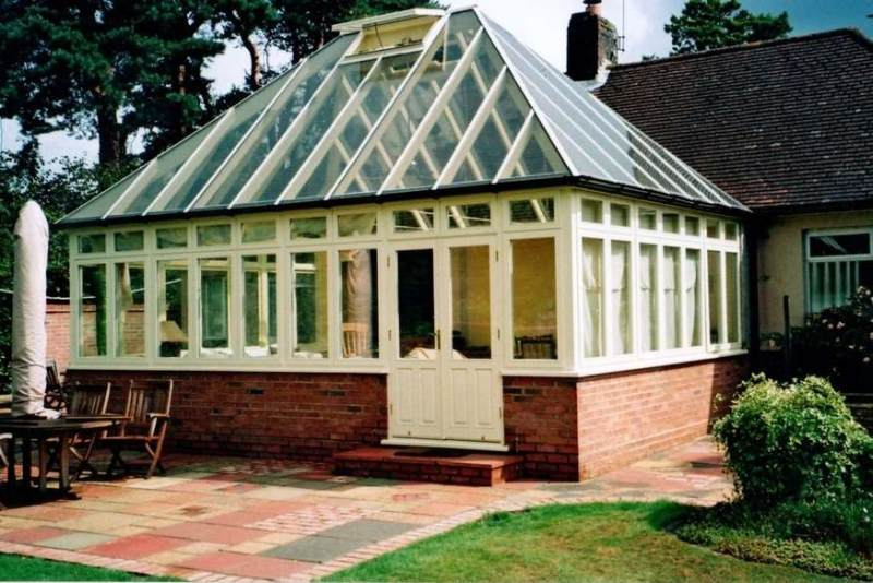 Cream finish hardwood conservatory with a 45 degree pitch roof to match the house near Hastings